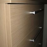 smėlinės penkerių stalčių akcijinės virtuvės komodos tekstūra